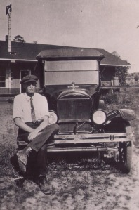 Jones Reginald Nanney resting on a 1923 T-Model Coupe in front of the Thermal City depot (no longer there)