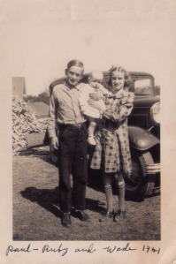 Troy Wade Nanney in 1941 spoiled by his siblings Paul and Ruby; note the pile of kitchen stove wood on the left