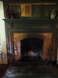 Mantle to the ceiling. The lighter wood is where a woodstove was installed in the 20th century.