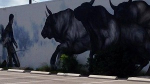 Bulls Charging Matador Street Art on Public Wall